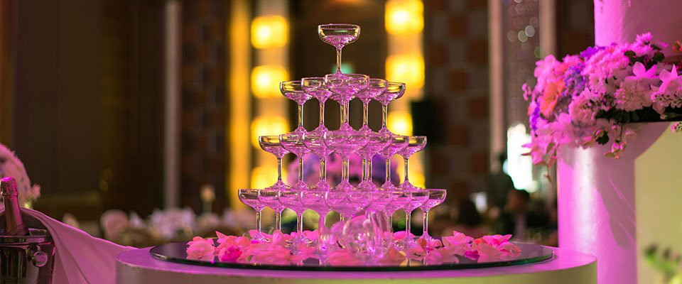 Wine glass pyramid on table