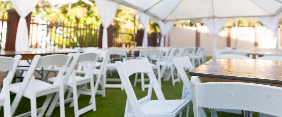 Folding banquet chairs around folding banquet tables